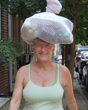 Dr. Doris Jeanette carrying her groceries on top of her head like women of old.