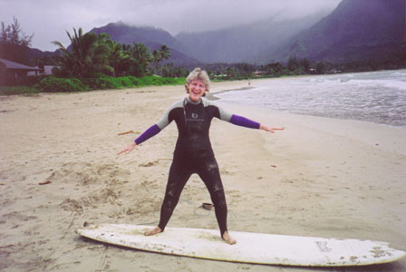 Dr. Jeanette learning to surf at 53