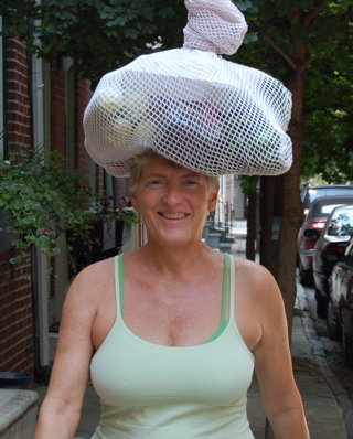 Dr. Doris Jeanette carrying her groceries on top of her head like women have done for centuries.